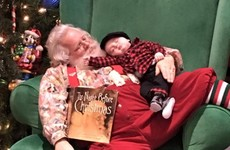 A little boy fell asleep before seeing Santa but they took the photo anyway