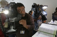 Dozens of journalists crowd into home of San Bernardino suspects