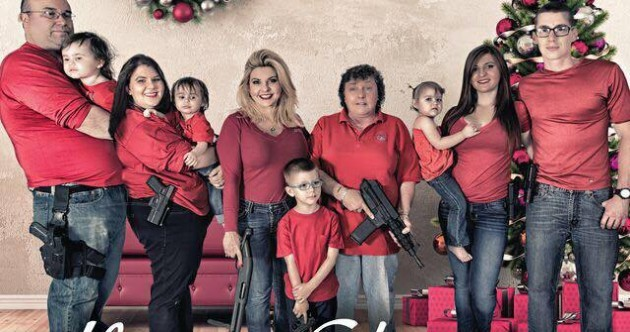 US politician posts Christmas portrait showing family posing with guns