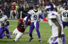 Cardinals defence swoops late to pick off Vikings and secure playoff berth