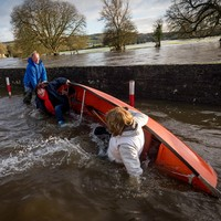 Pictures: the moment Joan Burton fell out of a boat in Kilkenny floods