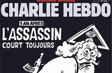 Vatican hits out at Charlie Hebdo for showing God carrying an assault rifle