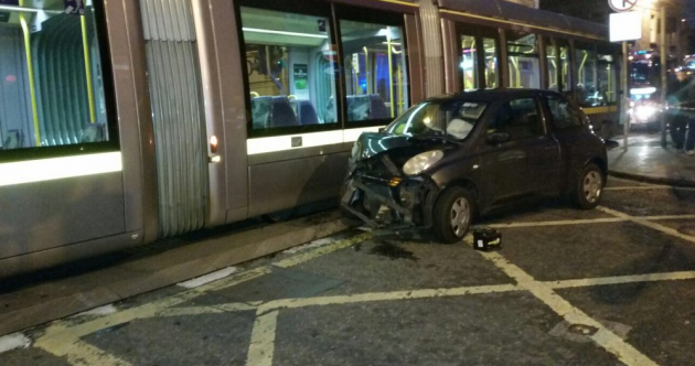 One person hospitalised after collision between car and Luas