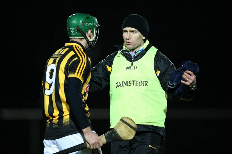 Kilkenny manager Eddie Brennan talks to Niall Mullins before the game.