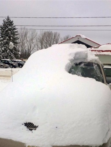Canadian man charged after driving a car almost entirely buried in snow
