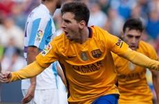 Messi grabs winner against Malaga to send Barcelona top