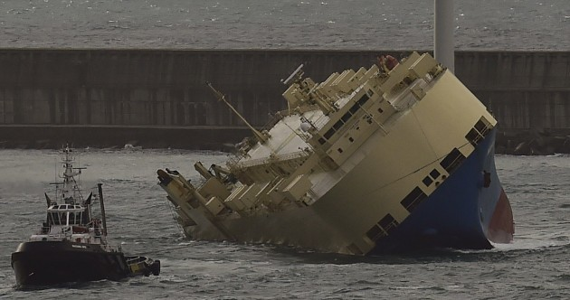 An enormous ship has been towed to Spain after it listed almost completely to one side
