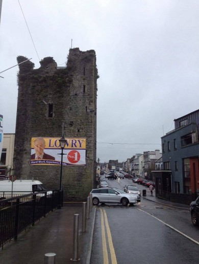 People aren't happy about this Michael Lowry banner erected on a 15th Century landmark