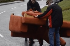 A video of two Tyrone fellas struggling to move a couch down a hill has gone global