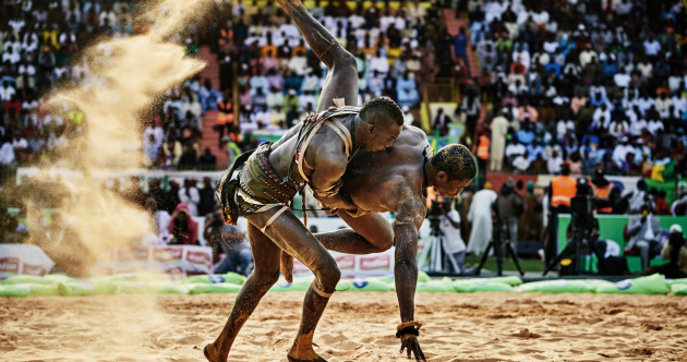 Ebola survivors play football, skiing crash and wrestling: The best sports photos of 2015