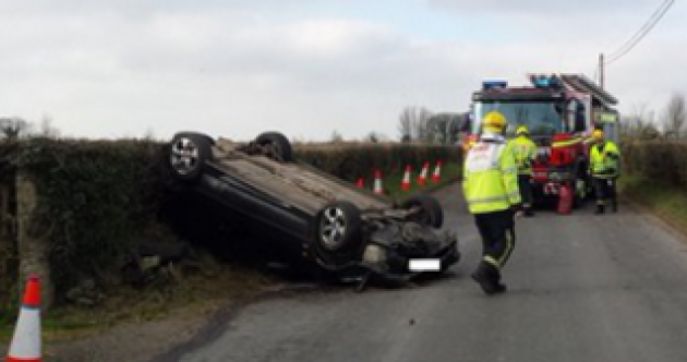 Car overturns after smashing into a speed limit sign
