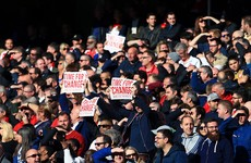 Wenger protesters clash during Arsenal game