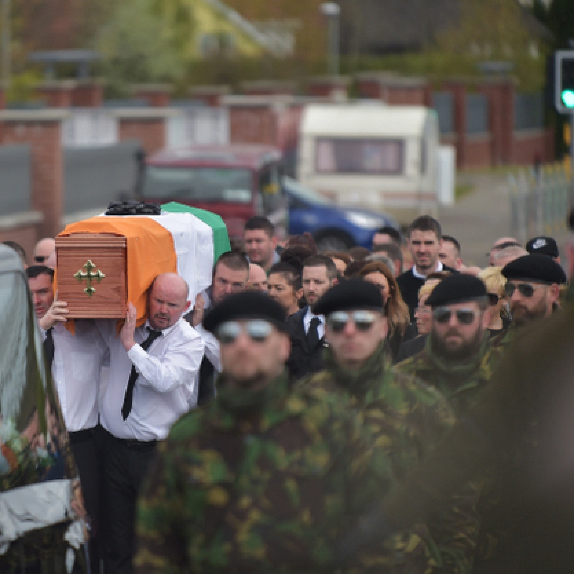 Police begin searches after arrests at paramilitary-style funeral