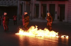 Greek protesters clash with riot police over further austerity reforms