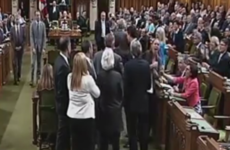 Canadian prime minister apologises for elbowing opposition MP