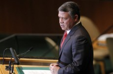 King of Jordan calls on Assad to step down in Syria's 'interest'