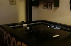 This Pong table is trying to bring the classic arcade game into the real world