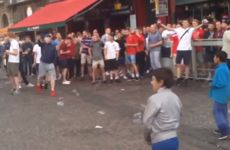 Videos show English fans throwing coins and jeering at migrant children