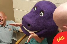 This teenager hilariously got herself stuck in a giant Barney the Dinosaur head