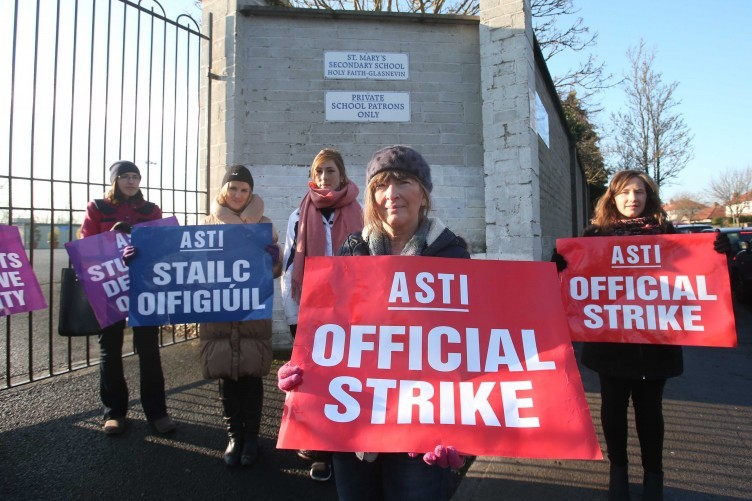 Nuala Walker (centre) a teacher from St Mary`s Secondy School Glasnevin Dublin outside the school with fellow teachers during a one day strike against reform of the Junior Cycle last year.