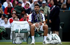 Djokovic saved by rain as Querrey takes two-set lead