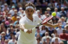 Federer battles from two sets down to win epic Wimbledon 1/4 final