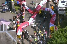Giant inflatable arch collapses and causes havoc at Tour de France