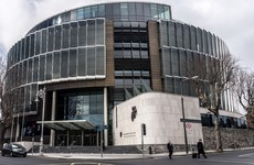 Brothers acquitted of assaulting elderly woman who believed they were involved in her son's killing