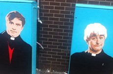 Someone has painted Ted and Dougal on these traffic boxes near Connolly Station