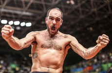 More topless celebrations as Ireland's Scott Evans qualifies for badminton knockout stages