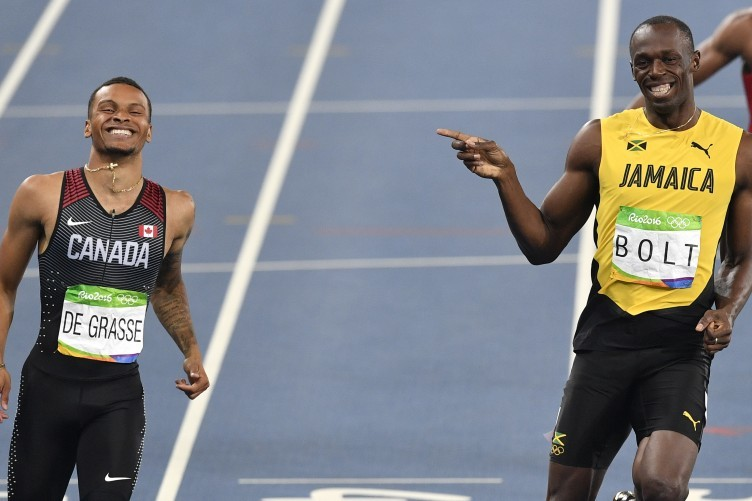 Jamaica's Usain Bolt and Canada's Andre De Grasse, left, compete in a men's 200-metre semi-final.