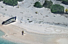 Two men washed up on uninhabited Pacific island saved after writing 'SOS' in the sand