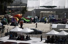 Thousands flee after fire started in Greek migrant camp