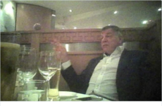 The internet can't decide if England's football manager is drinking a pint of wine in this photo