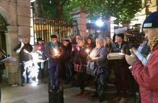 Silent candlelit vigil held outside Leinster House in memory of Carrickmines fire victims