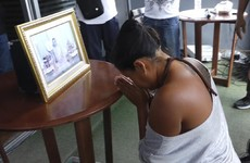 Woman forced to kneel before portrait of Thai king after 'posting disrespectful comments online'