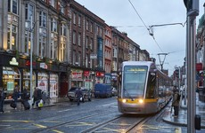 Woman who tried to jab Luas driver in the eye with broken bottle has jail term cut on appeal