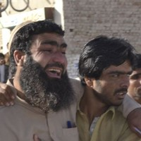 60 people killed after militants attack police academy in Pakistan while recruits sleep