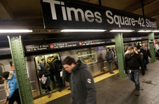 Woman killed after being pushed in front of subway train at Times Square station