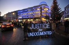 Hundreds of undocumented migrants stage candlelit march to Dáil