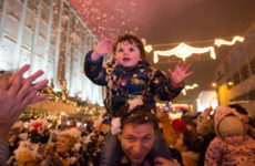 Young boy who survived six-storey fall from hotel balcony turns on Limerick Christmas lights