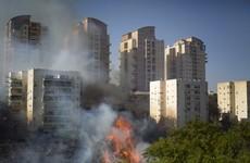 Israel warns of 'arson terror' link to bushfires, as 60,000 flee northern city of Haifa