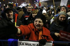 Romanian government backtracks on plan to decriminalise corruption after mass protest