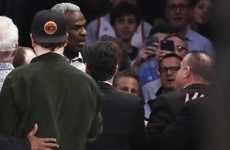 Former Knicks star Oakley dragged from stands and arrested following 'row with team owner'