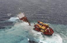 Grounded cargo ship breaks apart on New Zealand reef