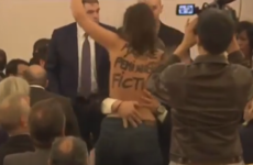 Topless protester disrupts Marine Le Pen speech