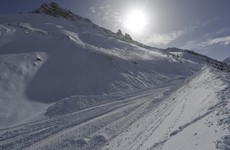 Two tourists dead - and two still missing - after avalanche at French resort