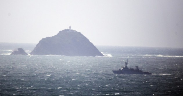 In 'hostile conditions', searchers find section of Coast Guard helicopter on Black Rock
