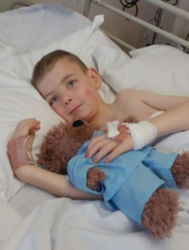 'He's very brave, he was in surgery for 10 hours': Tommy Long finally gets scoliosis operation