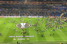 Violent clashes forced fans on the pitch and delayed Lyon's Europa League tie against Besiktas
